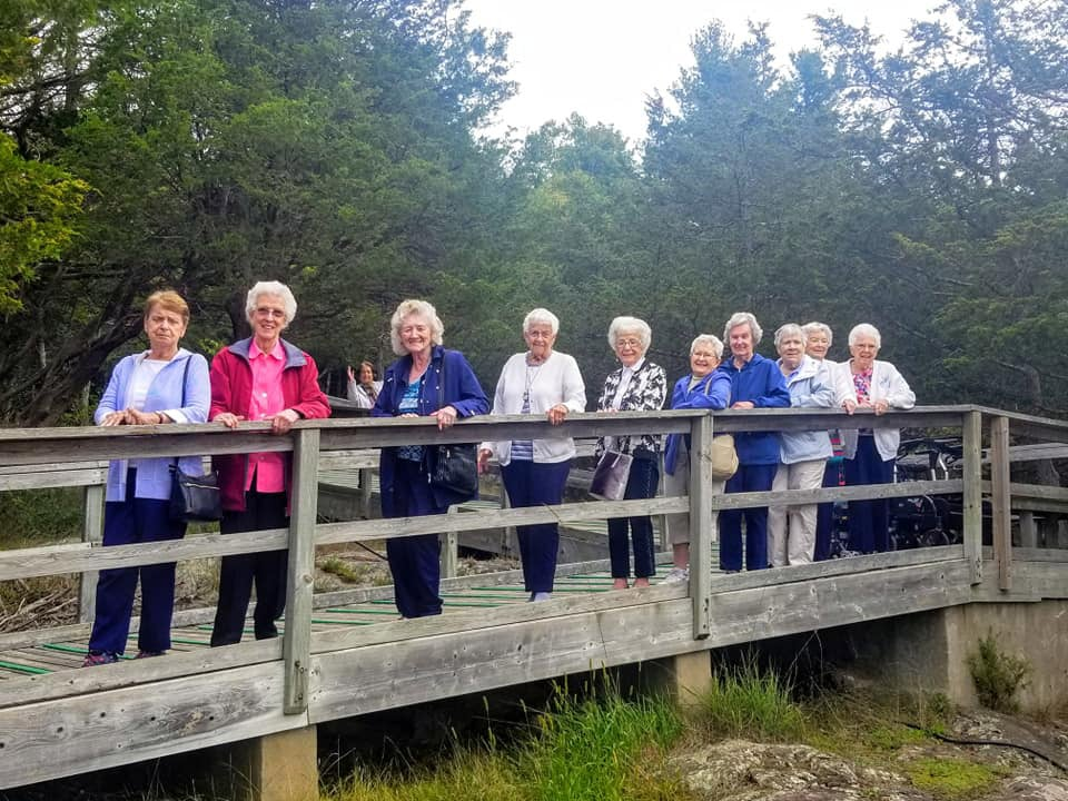 Women standing on bridge during Foxview Retirement Community Event
